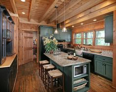 Painted cabinets, stone countertops, and distressed floors give the kitchen a vintage look with modern appliances. For more photos and to download floor plans:  http://www.modernrustichomes.com/design/portfolio/chestnut-lodge