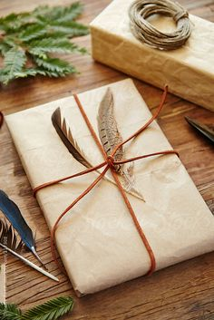 Hipster gift wrapped with paper, leather, and feathers felt like in hogwarts <3
