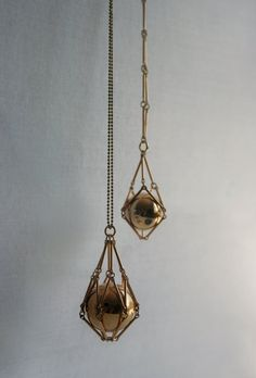 Gold geometric necklace with caged ball