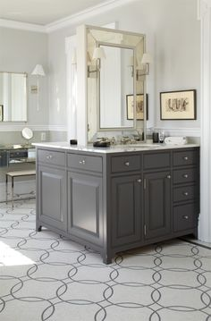 Stunning contemporary master bathroom design with soft gray walls and custom charcoal gray bathroom cabinets with antique mirror doors, and matching gray double floating vanity with marble countertop and his and her sinks. Grey Bathroom Cabinets, Grey Bathroom Vanity, Gray Vanity, Grey Bathrooms, Beautiful Bathrooms, Gray Cabinets, Bathroom Island, Bathroom Vanities, Luxury Bathrooms