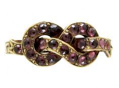 Georgian garnet loveknot ring