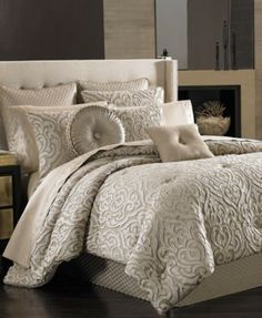 Traditional meets modern in the Astoria comforter set from J Queen New York. The taupe ground of the comforter and shams sets the stage for large scale damask embellishments in white and ivory that cr