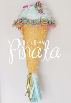 Ice Cream Cone Pinata. DIY! Love the mint color and tassels!