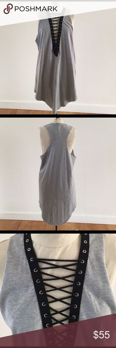 LF Emma and Sam gray lace-up tank dress BNWT LF Emma and Sam gray lace-up tank dress. Size small but in usually a medium so it is a little oversized. Curved hem so it goes up a little on the sides. Make me an offer! No trades! LF Dresses