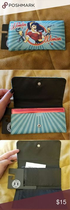 NWT Bombshell Wonder Woman threefold wallet Bombshell Wonder Woman threefold wallet. Lots of compartments. Shiny red edge on opening. NWT but has a few spots as pictured. Open to offers. Bioworld Bags Wallets