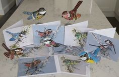Set of Four Greetings Cards with Birds by Barbara Franc The pictures are a Wren, a Greenfinch, a Great Tit and a pair of Long tailed Titmice made from decorative recycled tin.