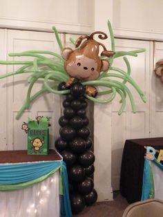 I like the palm tree with balloons! Could do for beach theme party or Monkey Themed Baby Shower