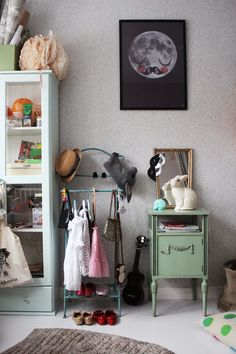 kids room, adorable use of a vintage butler stand Link to a very creative (and honest, with real kid messes) house all done in mellow grey, which allows calm, and colors to pop