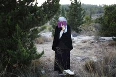 Jul. 1, 2014. A Jewish woman prays during the joint funeral of the three Israeli teens who were abducted and killed in the occupied West Bank, in the Israeli city of Modi'in.