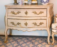 A LOUIS XV PROVINCIAL ORMOLU-MOUNTED AND GRAY-PAINTED COMMODE Mid-18th Century, remounted and redecorated - Sotheby's $7,000-$10,000 USD
