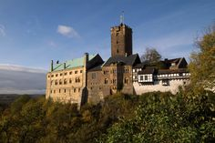 WARTBURG, Germany: is a castle whose building spanned centuries. The largest structure of the Wartburg is the Palas, originally built in late Romanesque style between 1157 and 1170. The Wartburg was the supposed setting for the legendary Sängerkrieg- the singing contest which inspired Wagner's much later Tannhäuser opera- as well as the home of St. Elisabeth of Hungary & the place where Martin Luther translated the New Testament of the Bible into German.