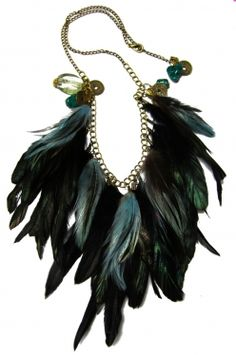 """hand crafted feather bib with blue and black plumes.   detailed with hand strung onix, agate and antique charms"""