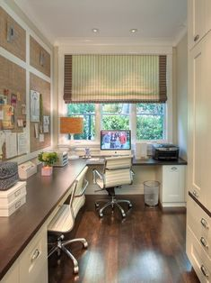 Love this spacious galley office with window and built in storage.