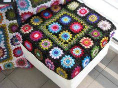 I should cover my old couch cushions with a granny square cover & use it on my outdoor gliders.