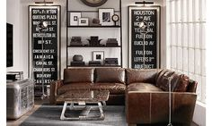 beautiful sophisticated man cave with brown leather couch