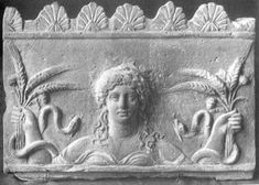 Demeter, Goddess of the Harvest, with wheat and snakes. Hellenic, terracota relief, third century B.C. Magna Graecia. (snakes were once a goddess symbol of rebirth)