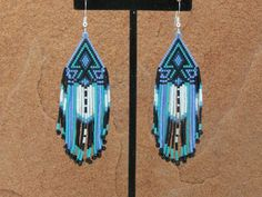 Cherokee Beaded Arrowhead Earrings In The Colors of Deep Metallic Blue, Soft Lavender With a Splash of Green Turquoise by LJ Greywolf These Native American Beaded Earrings with my new arrowhead design