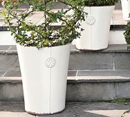 Definitely too expensive for me.  But I wonder if I get some galvanized steel buckets and drill a hole in the bottom, how'd they do.  I could even spray paint them white or another colour to match