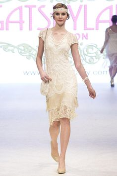 As seen Gatsbylady Vancouver Fashion Week Runway! A show stopper cream 1920s style flapper is polished distinction with a graceful cream soft stretch tulle overlay, cut to form charming scalloped cap sleeves and V neckline. Given a modern fit while preserving vintage look. A majestic