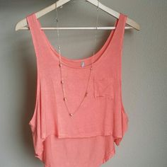 Coral high low cropped tank My favorite color!  Wear a cute bralette under this for added style. Rayon / spandex.  Brand new without tags.   2 medium available  1 large available   If you are interested in this item, I will create a custom listing for you :) Please do not purchase this listing. heart and hips Tops Crop Tops
