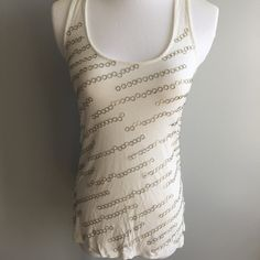 White Embellished Racer Back Tank In awesome condition only wore once. It's just been folded in my closet. Please no holds, trades, or Pp. Thank you!😊 Forever 21 Tops Tank Tops