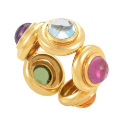 Tiffany & Co. Paloma Picasso Yellow Gold Gemstone Band Ring. The candy-colored design of this ring from Tiffany & Co's Paloma Picasso collection is absolutely stunning! The ring is made of 18K yellow gold and is set with five different colored gemstones. circa 20th century.