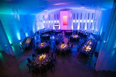 Different types of tables for corporate events. Blue lightening. Modern centerpiece with candles. Hanging chandeliers.  Event was for Creative Focus Inc. at The Temple House
