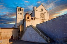 The upper facade of the Papal Basilica of St Francis of Assisi, ( Basilica Papale di San Francesco ) Assisi, Italy | Photos Gallery
