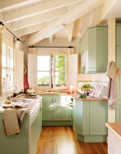 Cottage kitchen: Vaulted ceiling, wood floors, painted cabinets - bright and charming!