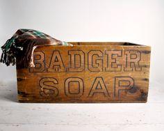 This antique crate to store fleece blankets, or as we Bildstens call them, beiges ... @Katherine Bildsten