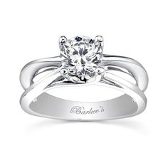 This contemporary so This contemporary solitaire engagement ring has a freeform split shank with rolling ridges that sport a prong set round diamond center. <br /> <br /> Also available in yellow gold, 18k and Platinum.