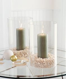 Fill hurricane glasses with pebbles and pillar candles for pretty indoor or outdoor lighting. Make them holiday special by using cranberries instead of pebbles for Christmas, colored marbles for lots of holidays (green for St. Patrick's Day, red, white and blue for Memorial Day or the 4th of July, etc.), red hot candies for a red hot Valentine's Day, orange and black jelly beans for Halloween, peas or other dried beans for Thanksgiving, or, well....the possibilities are endless!