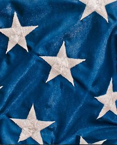 Close up of American Flag. Blue with white stars.