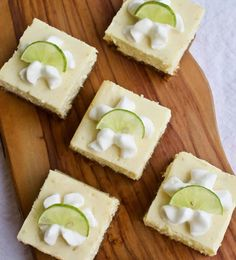 Key Lime Cheesecake Bars with Raspberry Sauce   Yummy Noises Raspberry Preserves, Raspberry Sauce, Key Lime Cheesecake Bars, Best Key Lime Pie, Slice Of Lime, Refreshing Desserts, Graham Cracker Crumbs, Stick Of Butter, Dessert Bars