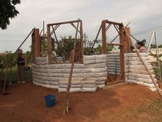 A while back I did a post: How to Build an Earthbag Dome this was a windowless dome building which would make a great root cellar or storage shed. Today I am sharing a tutorial to build a an earthbag roundhouse, complete with windows and doors.  This is very cheap and easy way to build a one room dwelling.  The cost per sq foot of living space is just $11.50; anyone in the construction business knows that is crazy cheap….  The finished house looks beautiful, inside and out.
