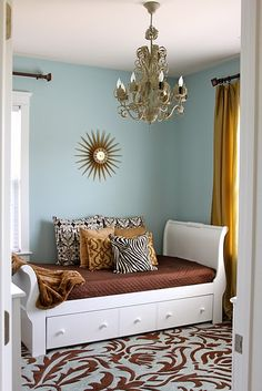 blue walls with white and mustard/rust