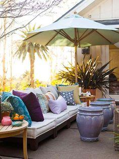 Plant pot cocktail tables, blues, periwinkle tea; patio.