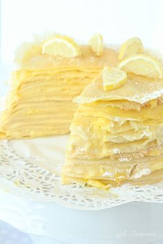 Lemon Crepe Cake - a tower of crepes, unbelievably dense, layered with pastry cream and lemon filling- warm the slices in the microwave for a minute - these are not great when cold. Lemon Desserts, Lemon Recipes, Just Desserts, Sweet Recipes, Cake Recipes, Snack Recipes, Dessert Recipes, Cooking Recipes, Crêpe Recipe
