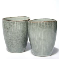 Broste Pair Of Grey Hand Decorated Ceramic Cups: A stunning pair of hand decorated ceramic cups. These beautiful ceramic cups have a rustic organic feel with a smooth gently undulating rim. Each one is hand decorated and unique in shape and colour, glazed in grey with a white line design and darker grey rim.