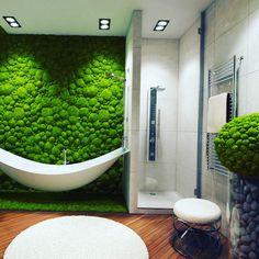Łazienka na zielono, mech na ścianie.