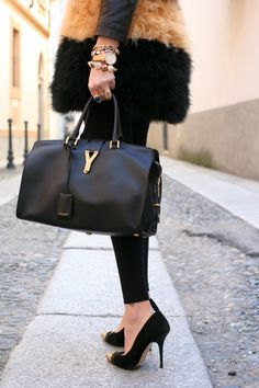 Saint Laurent bag, cap toe pumps , fur vest, très chic!