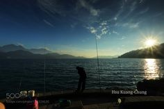 http://500px.com/photo/186324635 Sunset and Angler by HsuKuangChung -I seldom take pictures of Sun-Moon Lake's sunset but this time is a new experience.. Tags: skylandscapelakemountainswatercloudsfishing rodanglerSunsetTaiwanSun-moon lakeNan-tou county