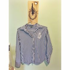Ralf Lauren-Blue & White Striped Button-up Perfect for the nautical/vintage look! Super classy. In perfect condition. Never worn. Size Large, but looks cute as a loose fitting shirt on smaller frames, too! Ralph Lauren Tops Button Down Shirts