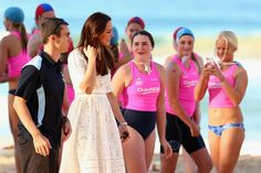 Catherine, Duchess of Cambridge talks to surf life-savers at Manly Beach during a surf life-saving presentation