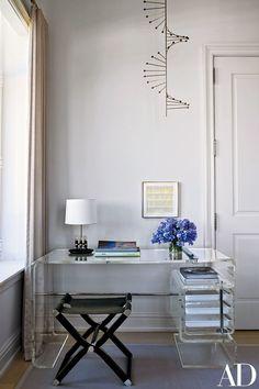 A circa-1956 Poul Kjærholm candelabra is suspended above the master suite's vintage Rena Dumas desk | archdigest.com
