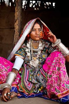 Portrait of a Marwada Meghwal Harijan woman wearing traditional clothing and a large golden wedding ring through her nose, Hodka, located roughly from Bhuj in the Kutch District, Gujarat, India Cultures Du Monde, World Cultures, Costume Ethnique, Yoga Studio Design, Bohostyle, Tribal People, Mode Boho, Indian Textiles, We Are The World