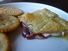 Individual baked bries with preserves are my new go-to portable food, far ahead of Go-gurt or Ren-Fair turkey legs. Great for entertaining, too.