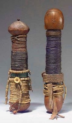 Africa | Dolls from the Ambo people of Namibia or Angola | Cylindrical body covered with multiple beaded necklaces of different shapes and colors, leather, fabric, natural fiber