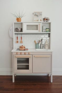 modern ikea play kitchen hack - almost makes perfectYou can find Play kitchens and more on our website.modern ikea play kitchen hack - almost makes perfect Play Kitchen Diy, Ikea Kids Kitchen, Kitchen Hacks, Kitchen Modern, Toddler Kitchen, Ikea Childrens Kitchen, Kitchen Storage, Kitchen Trends, Kitchen Decor