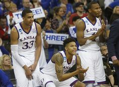Kansas forward Landen Lucas (33, Kelly Oubre, Jr. (12) and Wayne Selden Jr. (1) cheer from the bench in the Jayhawks' second-round NCAA Tournament win against New Mexico State Friday, March 20, 2015 at the CenturyLink Center, Omaha, Neb.